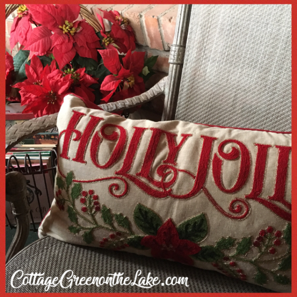poinsettia and holly jolly pillow.png