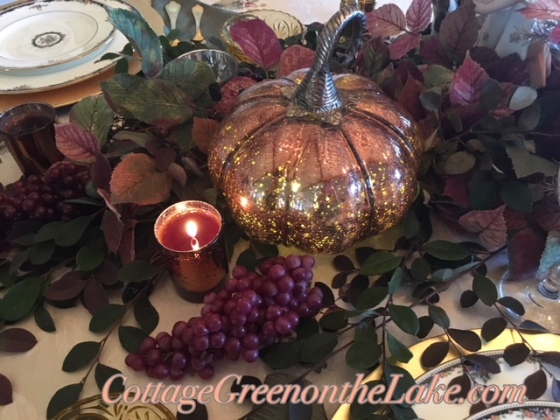 pumpkins, grapes, candlelight